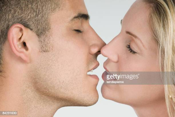 Close up of Hispanic couple kissing