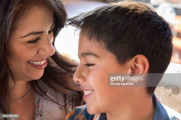 Close up of Hispanic mother and son smiling