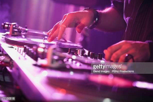Close up of Hispanic nightclub dj