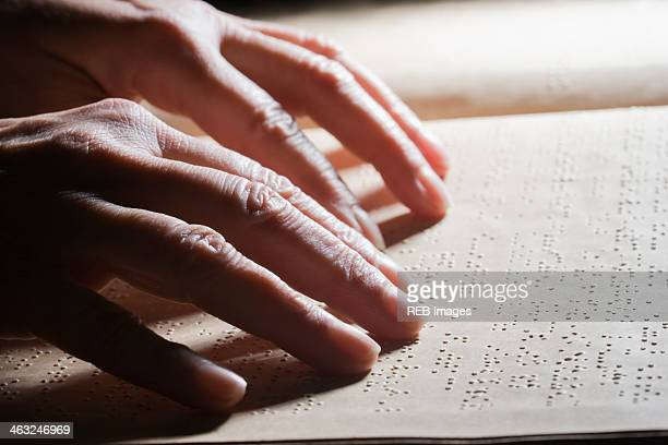 close up of hispanic person reading braille - braille stock pictures, royalty-free photos & images