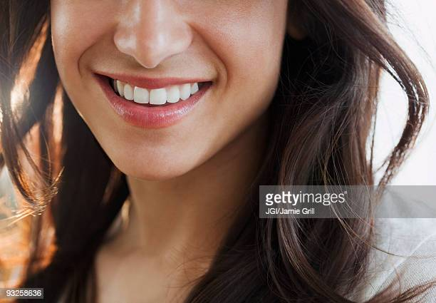 Close up of Hispanic woman's smile
