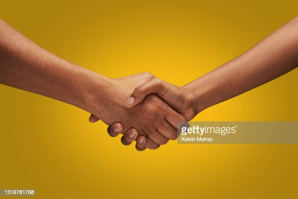close up of holding hands - handshake stock pictures, royalty-free photos & images