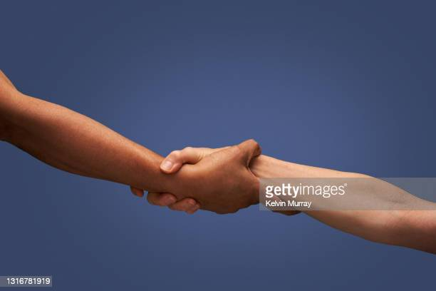 close up of holding hands - hand stock pictures, royalty-free photos & images