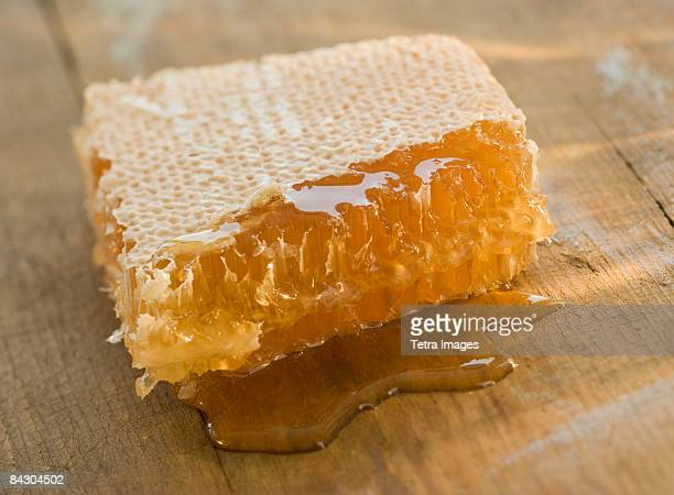 Close up of honeycomb dripping honey