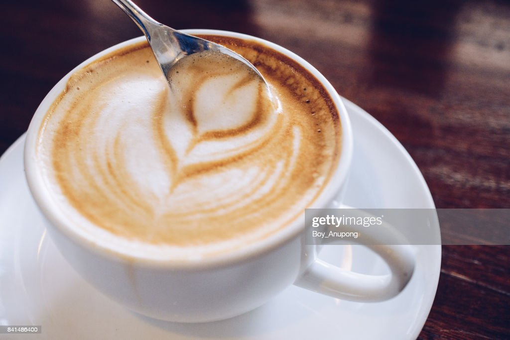 Close up of hot latte coffee on the wooden table. : Stock Photo