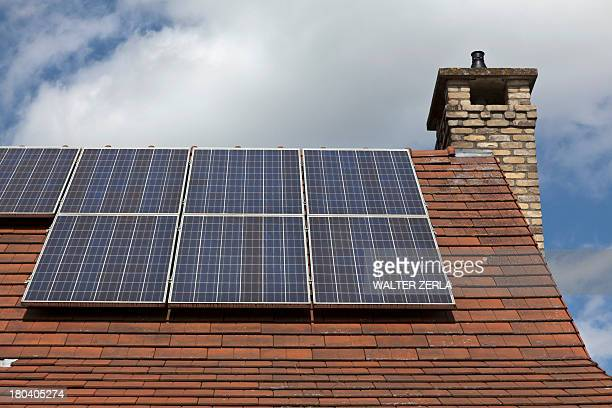 Close up of house roof with solar panels