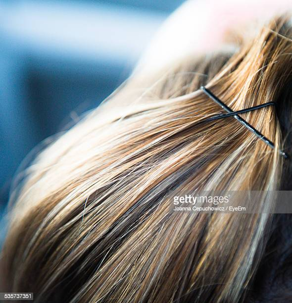 close up of human hair with hairpins - hairpin stock pictures, royalty-free photos & images