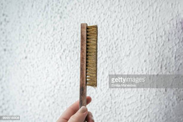 Close up of human hand holding scrubber brush