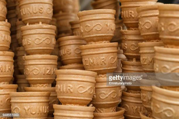 """close up of ice cream cones with """"izmir"""" printed on them. - emreturanphoto stock pictures, royalty-free photos & images"""