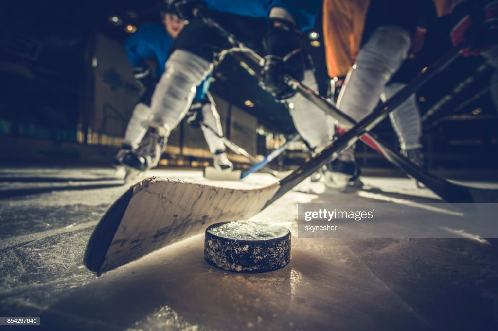 Close up of ice hockey puck and stick during a match. : Stock Photo