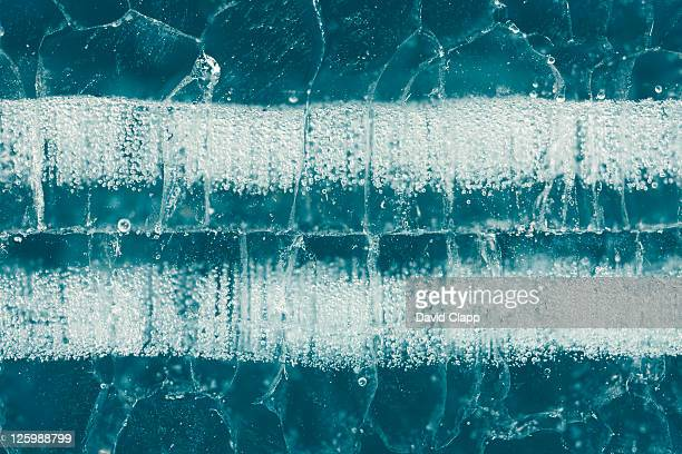Close up of ice patterns on frozen glacial lake, Abraham Lake, Canadian Rockies, Alberta, Canada (15th February 2010)