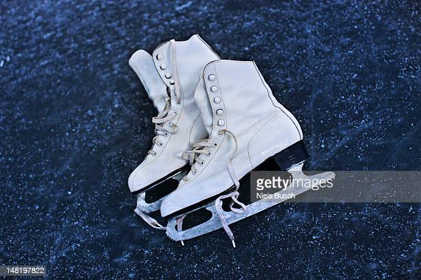 close up of ice skates on ice - ice skate stock pictures, royalty-free photos & images