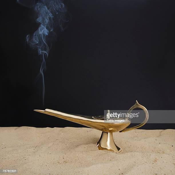 close up of incense burner on sand - lampara de aladino fotografías e imágenes de stock