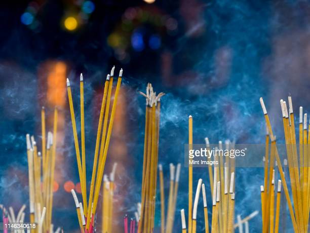 close up of incense sticks burning - シェムリアップ ストックフォトと画像