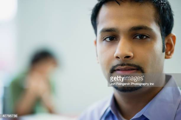 Close up of Indian businessman looking serious