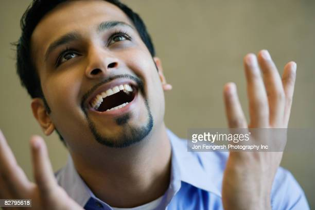 Close up of Indian businessman smiling and gesturing