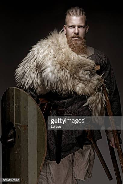 Close up of individual viking warrior in emotional pose