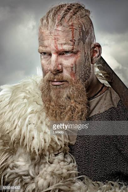 Close up of individual viking warrior in emotional pose
