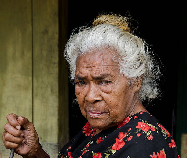 close up of indonesian senior woman - furious asian old lady stock pictures, royalty-free photos & images