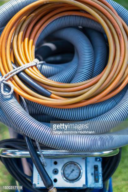 close up of industrial vacuum cleaner hose and cables used for cleaning homes by a professional service - industrial hose stock pictures, royalty-free photos & images