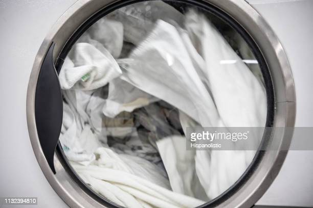 close up of industrial washing machine at a laundromat - laundry stock pictures, royalty-free photos & images