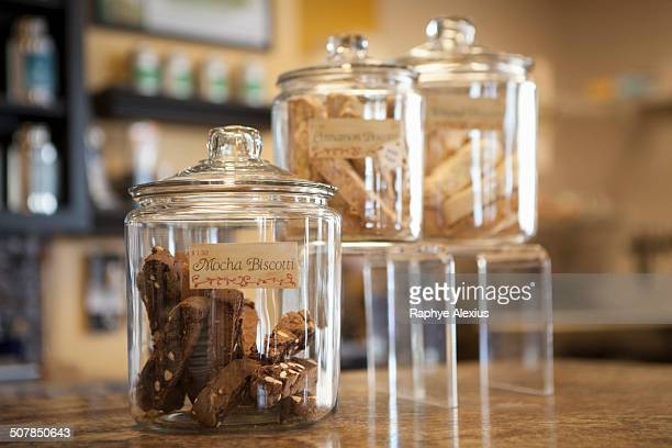 Close up of jars of biscotti on cafe counter