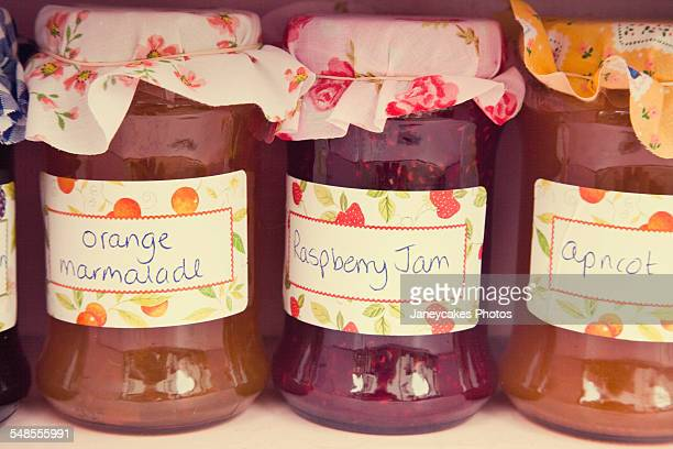 Close up of jars of homemade jam and marmalade