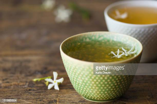 close up of jasmine tea in teacup - herbal tea stock pictures, royalty-free photos & images