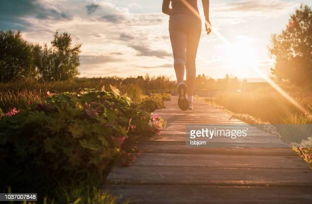 close up of jogging. - sunlight stock pictures, royalty-free photos & images