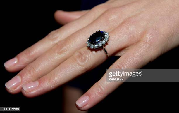Close up of Kate Middleton's engagement ring as she poses for photographs in the State Apartments with her fiance Prince William of St James Palace...