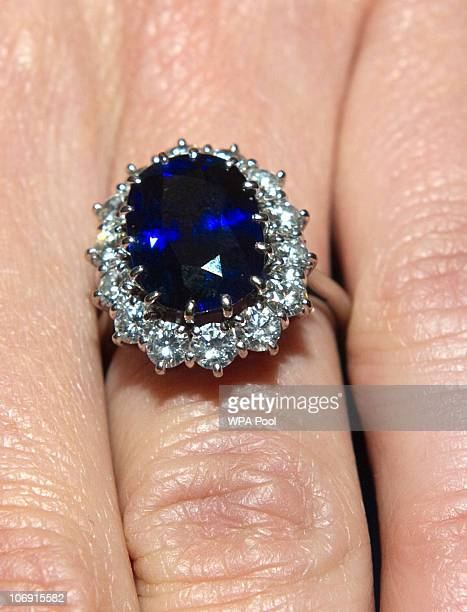 A close up of Kate Middleton's engagement ring as she poses for photographs in the State Apartments with her fiance Prince William of St James Palace...