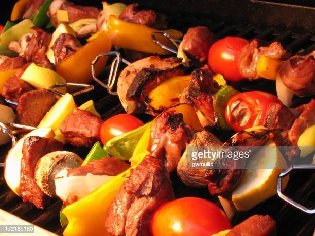 Close up of kebabs on a grill