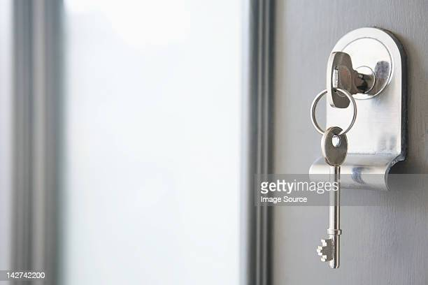 close up of key in a front door - house key stock photos and pictures