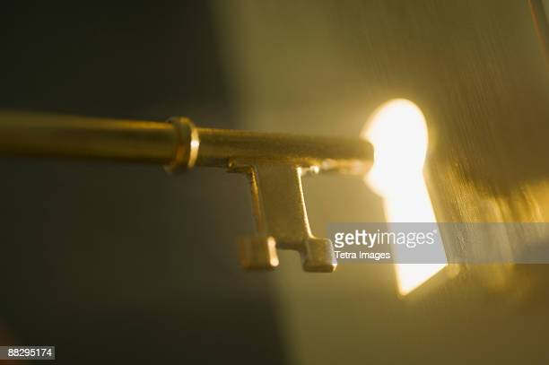 close up of keyhole and key - chance stock pictures, royalty-free photos & images