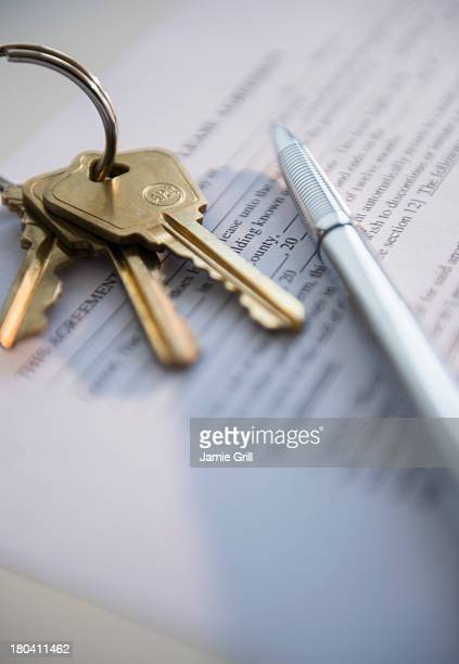 close up of keys and document, studio shot - lease agreement stock photos and pictures