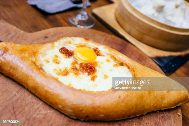 Close up of Khachapuri boat cheese on the plate
