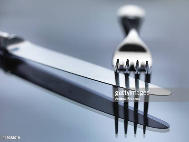 Close up of knife and fork on table
