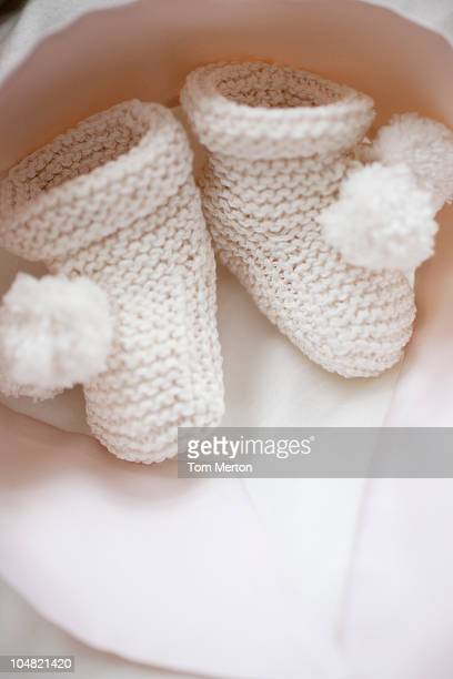 Close up of knit baby booties