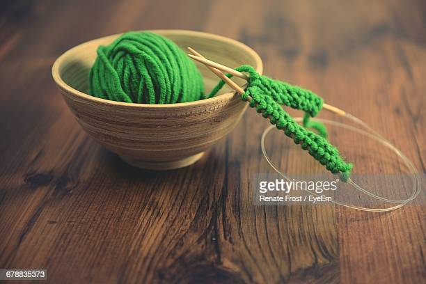 Close Up Of Knitting Wool On Wooden Table