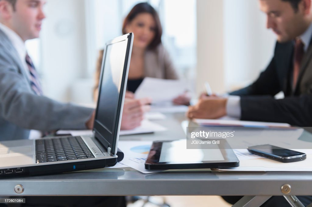 Close up of laptop, tablet computer and cell phone in office : Stock Photo
