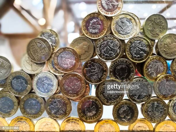 close up of large collection of donated british pound coins inside charity box, london, uk - inflation stock photos and pictures