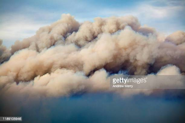 close up of large smoke cloud in sky from forest fire, bushfire, air pollution, australia - australia bushfire stock pictures, royalty-free photos & images