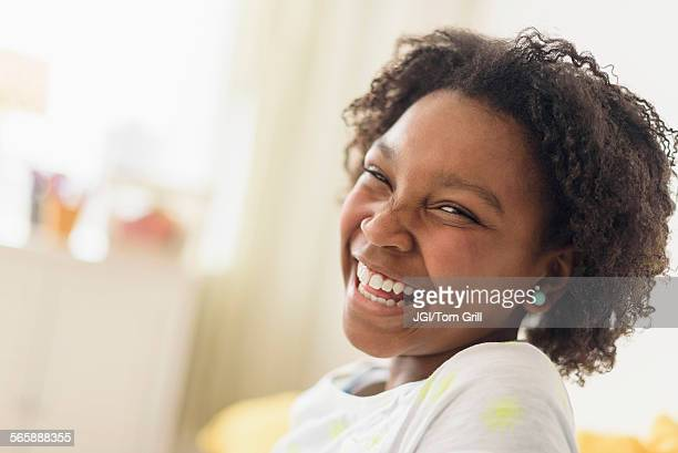 close up of laughing black girl - funny black girl ストックフォトと画像