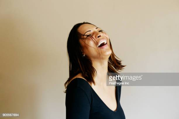 Close up of laughing mixed race woman
