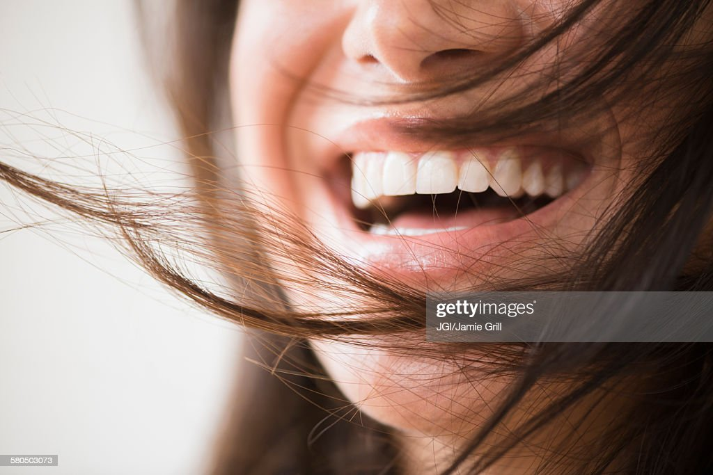 Close up of laughing woman with messy hair : Stock Photo