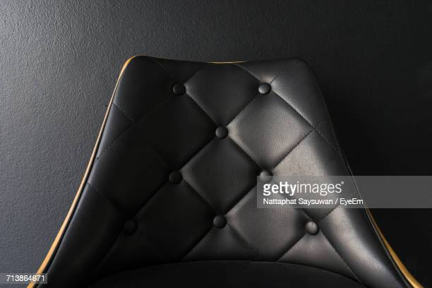 Close Up Of Leather Chair Against Black Background