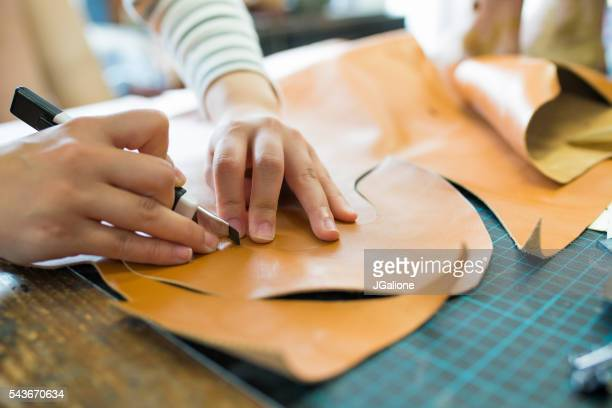 close up of leather cutting - calzature di pelle foto e immagini stock