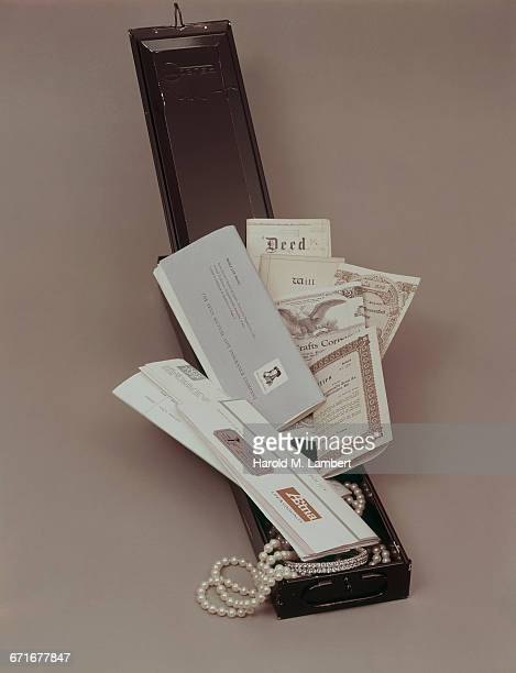 close- up of legal document and pearl necklace  - {{ contactusnotification.cta }} stockfoto's en -beelden