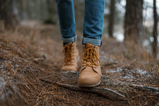 Close up of legs walking in the forest 517872710