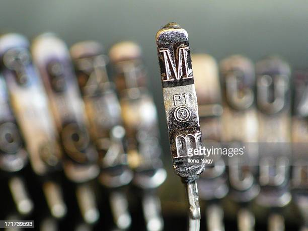 Close up of letter M on an old typewriter.